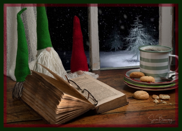 Snow scene, old book, glasses, Christmas Decorations, Christmas Cookies. Snowy trees